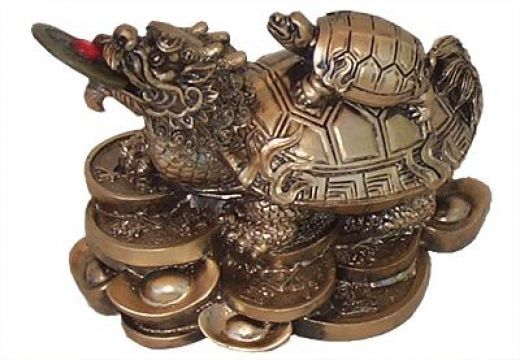 Dragon Turtle sitting on bed of coins usually with a baby tortoise on its back is a symbol of good luck, longevity, protection, harmony and money in Feng Shui.  Check this hub for meaning and placement.