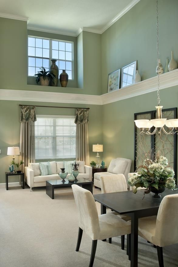 The running Shelf around the room and the window decor are a great way to  visually balancea high ceiling.
