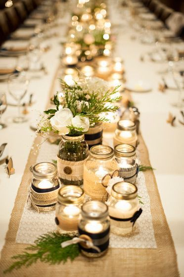 Military winter wedding, Devils thumb ranch, DIY, table center pieces, mason jars, candles, assorted sizes, romantic, warm lighting / http://www.deerpearlflowers.com/50-ways-to-incorporate-mason-jars-into-your-wedding/2/