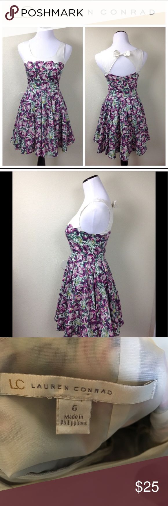 """Sleeveless Open Back Floral Dress Only worn once for my graduation! Gorgeous dress with an open back and accent bow. The Floral pattern is breathtaking and the style is extremely flattering. Did not come with belt, but looks cute without (or add your own!). ~17"""" chest; ~14"""" waist, ~34"""" length. Comes with FREE new Trifle Cosmetics Raspberry Ripple- Ombré Radiance Blush Palette (when purchased at full price, unless bundled) LC Lauren Conrad Dresses"""