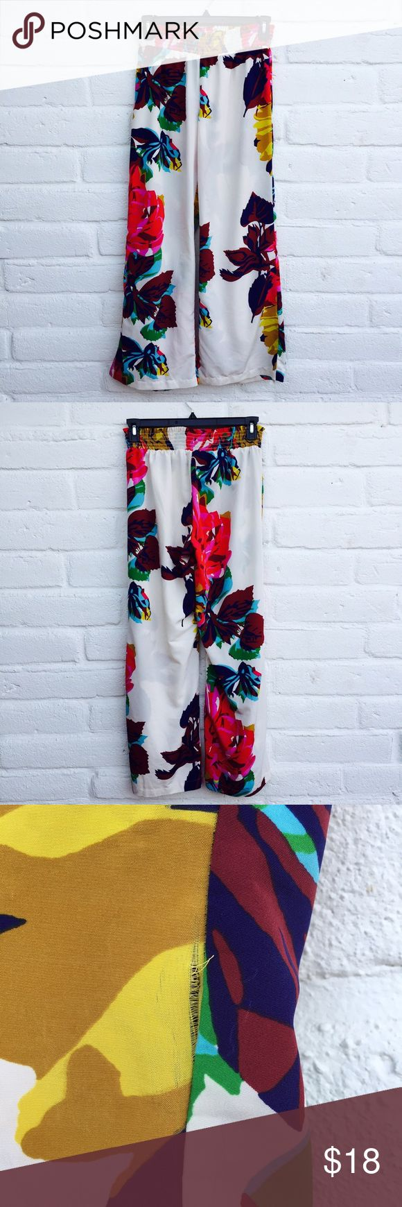 Anthropologie Pinkerton Wide Leg Palazzo Pants Pinkerton brand sold through Anthropologie. Wide leg, palazzo pants with elastic waistband. These are super comfortable and could even be suitable for maternity because of the stretchy waist band. White with a bright Floral pattern. Silky and soft, 100% polyester. There are two spots where the side hem is coming loose, I did not even notice this flaw while wearing because it's in a busy location and pants are loose fitting. Could easily be…