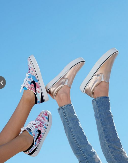 The cutest sneakers for your kids' spring break. Love the shiny, rose-gold  metallic VANs slip-ons and the floral Nike shoes. Kickin' it in style!