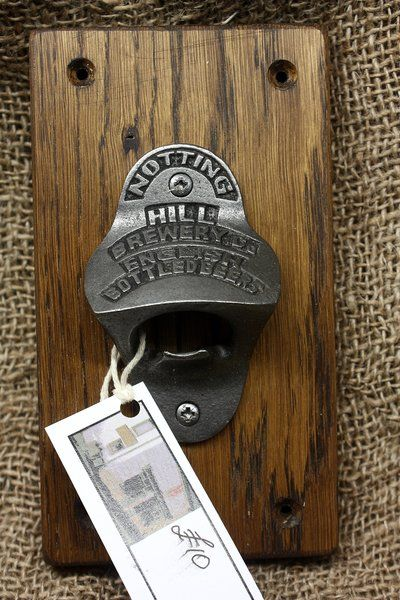 Cast iron Notting Hill bottle opener on oak | The Wooden House