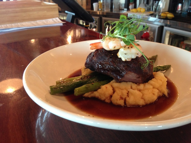 Braised Beef Cheek w/ roast garlic mash, brocolini, grilled prawns & red win jus. Available @ The Quarie