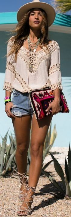 Lovely lace bohemian top paired simply with denim shorts and lace up sandals | Our Top 10 Bohemian Chic Outfit Ideas to Copy