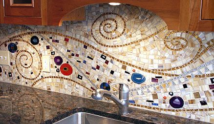 Mosaic backsplash made by mixing and matching varying materials of different sizes, shapes, colors, and textures