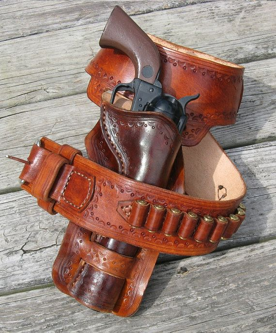Heavy leather (8 oz. - 10 oz.) western gun belt and double loop holster. All handmade. Twelve cartridge loops.  This item is not stocked, it