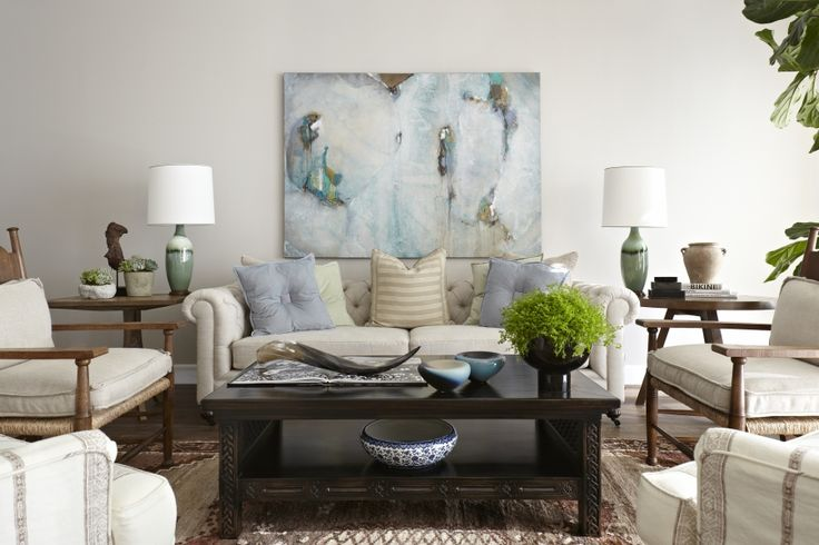 Love the walls, the muted greys, greens, blues and browns - this is a lounge I could lounge around in all day.