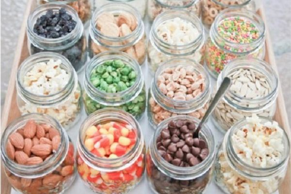 Assemble mason jars and all the fixings for a fun interactive trail mix buffet.