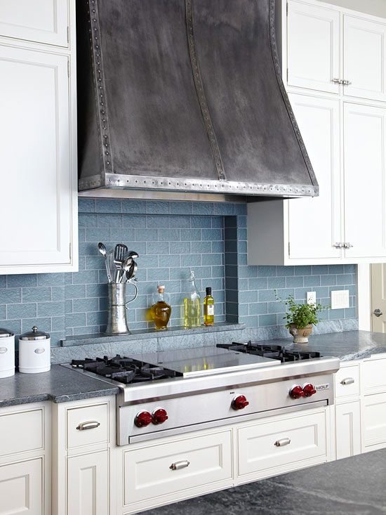 I love the industrial inspired range & hood paired with the textured blue backsplash
