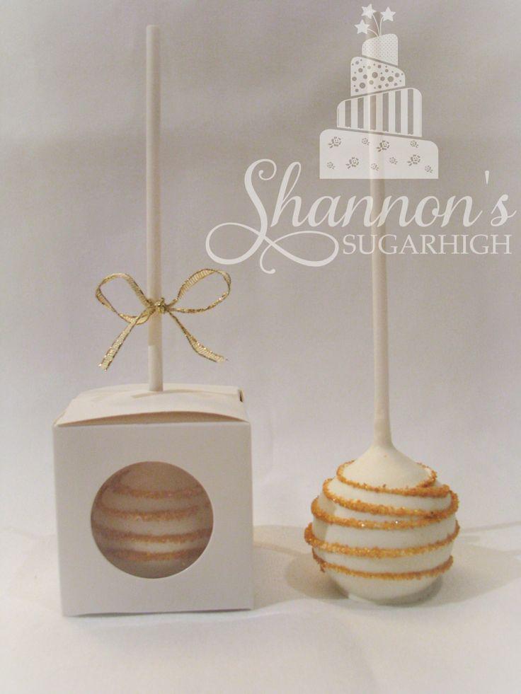 Red velvet cake pops; cream with edible gold glitter stripes. Packaged in cake pop box by Wilton.