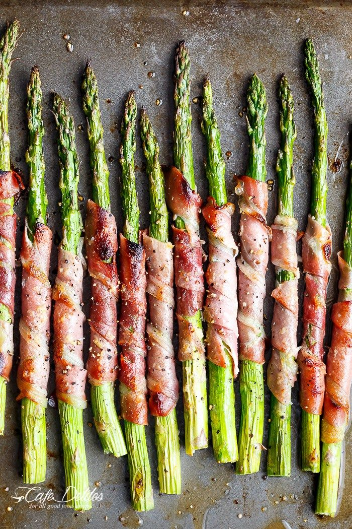 Garlic Butter Prosciutto Wrapped Asparagus are simple and quick to make. The ultimate finger food, side dish or appetiser! | http://cafedelites.com