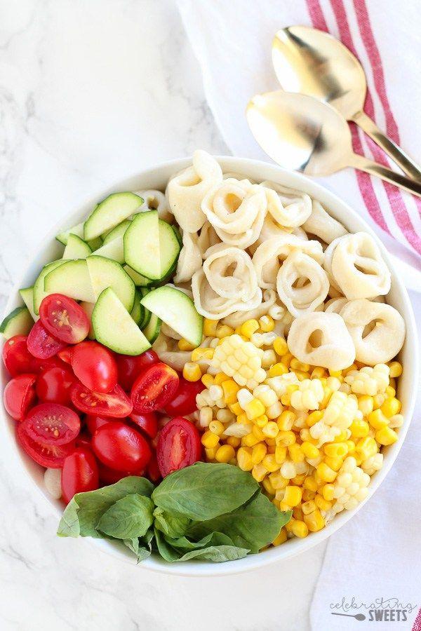 Summer Corn , Tomato and Tortellini Pasta Salad - A summery pasta salad filled with cheese tortellini, corn, tomatoes, zucchini and basil topped with a fresh lemon vinaigrette. Serve chilled or at room temperature.