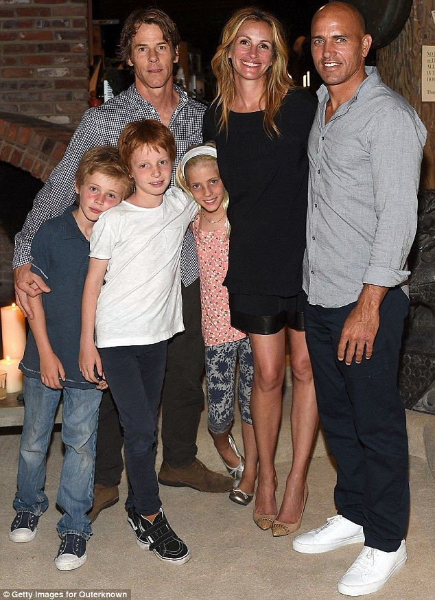 Family affair: The actress, her husband and the couples' three children, (L-R: Henry, eight, twins Phinnaeus and Hazel, 10 ) celebrated the launch of surfer Kelly Slater's (far right) clothing line in August