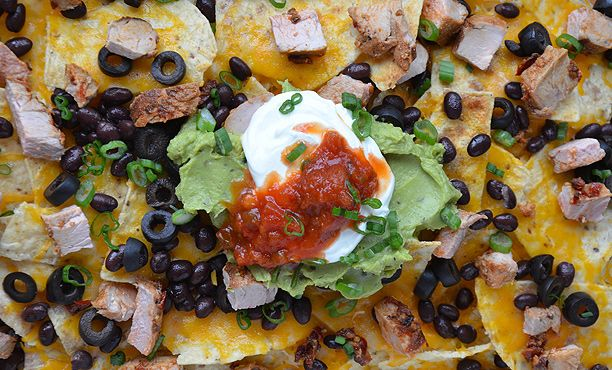The Ultimate Nacho Generator: Mix and match your way to a winning Super Bowl snack strategy with 10 takes on chips, cheese, and toppings | Epicurious.com