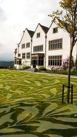 At Cumbrian Arts and Crafts house, Blackwell, artist Steve Messam has fashioned something he calls LawnPaper. Patterns based on wallpaper designs by William Morris have been created in the grass through a process of selective shading and trimming. Image via Culture24.