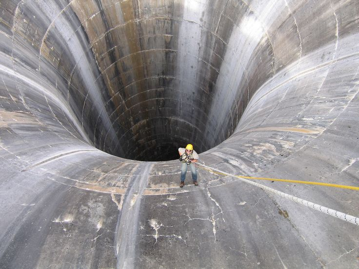 Brian Hollis rappels into Gibson Dam glory hole spillway. Photo by Joe Rohde, Reclamation.