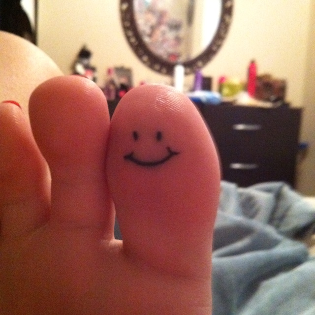 There's no better reminder to be happy than a smiley face tattoo on your big toe!
