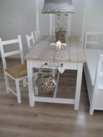 """I like the idea of hanging things at the end of the table.  And I want an """"eat in"""" kitchen table instead of an island....after all, it IS an island..."""