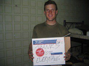 A soldier displays his thanks and gratitude for the care packages he and his fellow soldiers received. photo by nukeit1 on Flickr