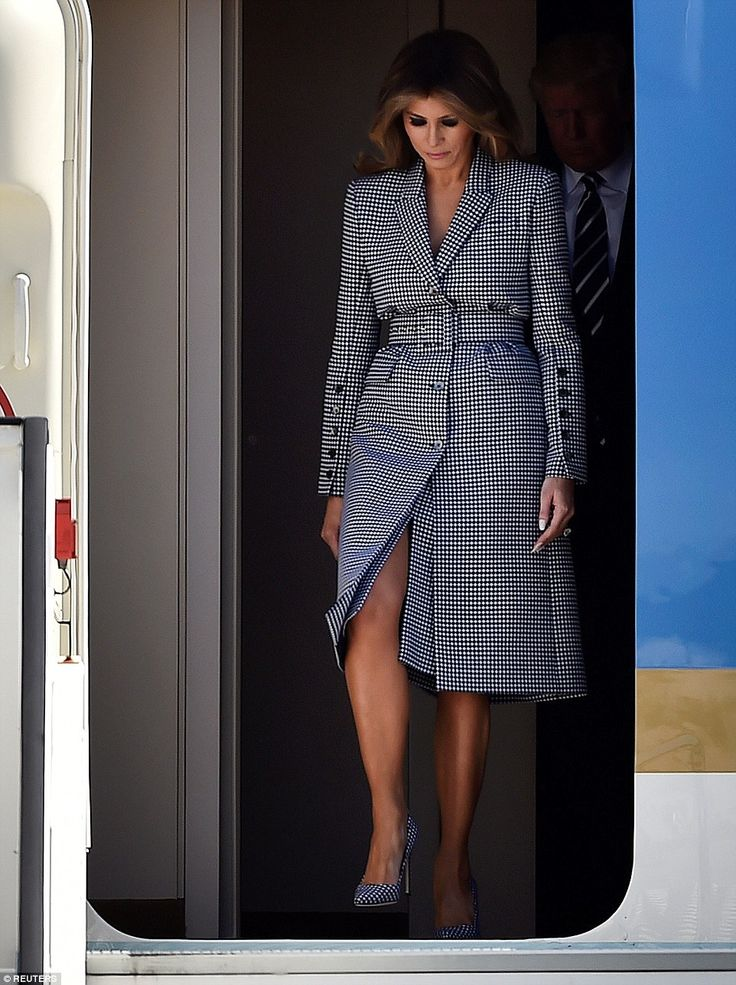 Melania, 47, stepped off Air Force One at the Melsbroek Air Base in Steenokkerzeel in a blue and white checked suit that complemented President Donald Trump's navy and white striped tie.