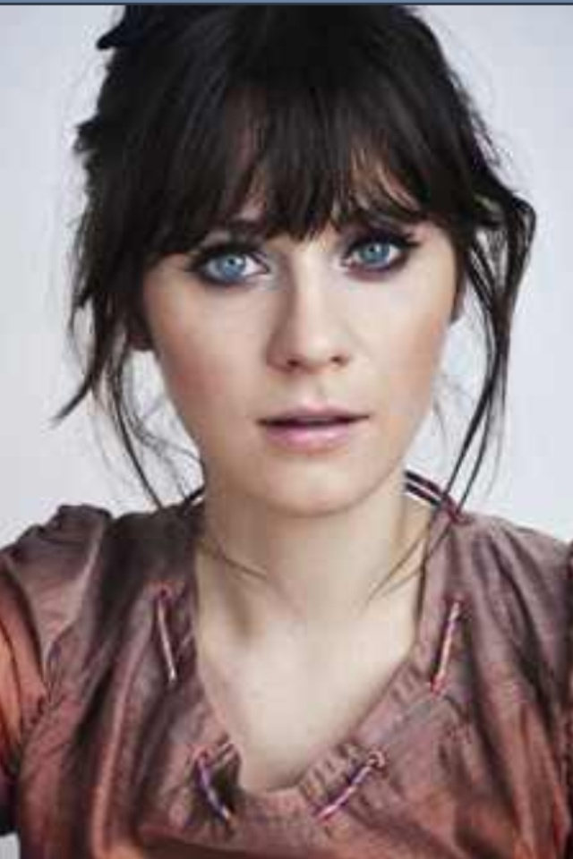 Zooey Deschanel- hair. Leave wispy's framing face when cutting bangs