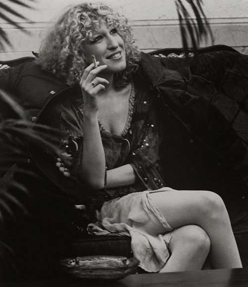 "Bette Midler in the '70s.  /  Hippy Glam . . . She was Loose as a Goose, High as the Sky,  all about all that was about her . . .  she was a ""bad girl"" and didn't care --- the way her face doesn't care when she sings. The way her voice doesn't care what you think when she would 'go there'.  . .   BRAVE.  Brave girls like her have always been called 'Bad Girls'. Early Miss M was truly Divine, in the Baddest sense. . ."