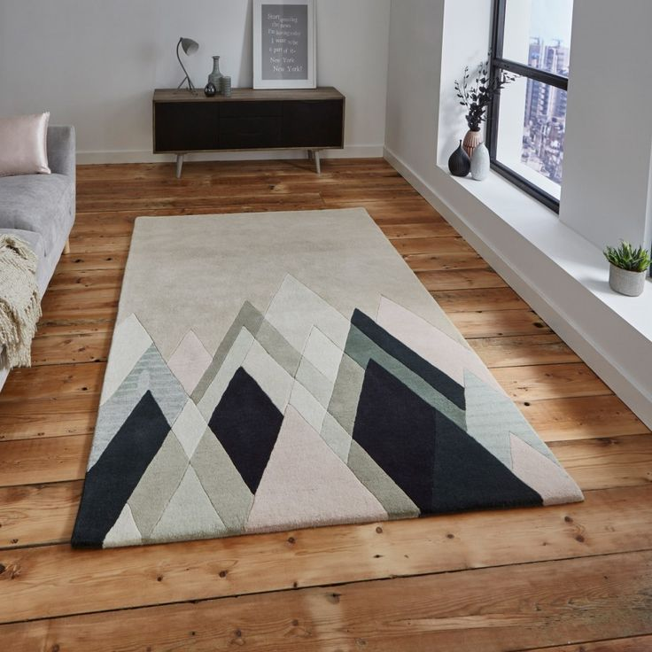 Michelle Collins MC21 Abstract Rug By Think Rugs The exclusive design of the Michelle Collins MC19 Designer Rug offers a geometrical abstract pattern displayed in shades of black, greys and beiges. This dazzling rug includes a unique arranged shape design, creating a real eye catching piece. #viscoserugs #woolrugs #modernrugs #luxuryrugs #abstractrugs