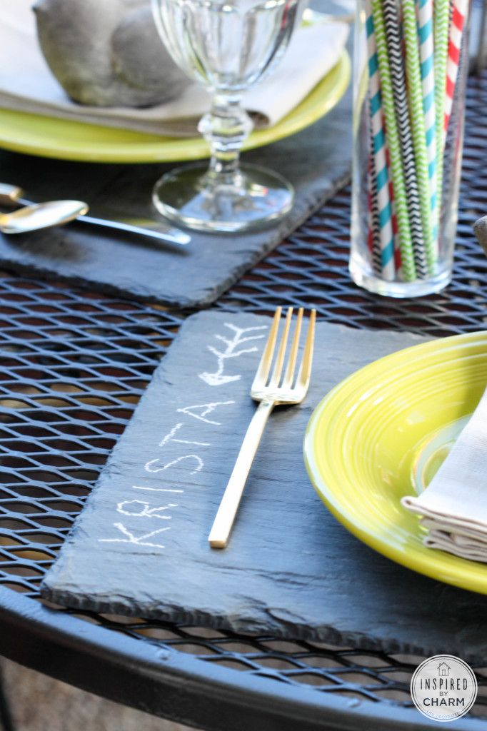 Use a slate board as a placemat which doubles as a place marker which triples as a doodle board