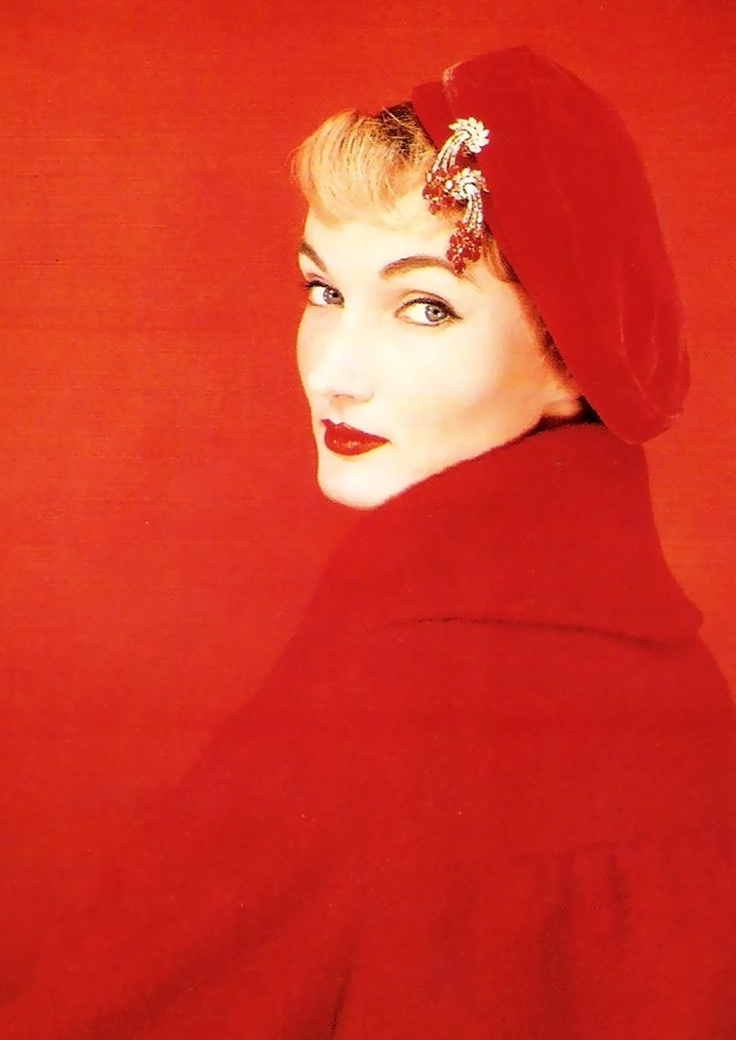 Evelyn Tripp in Nettie Rosenstein Coat & Cartier jewels, 1955.