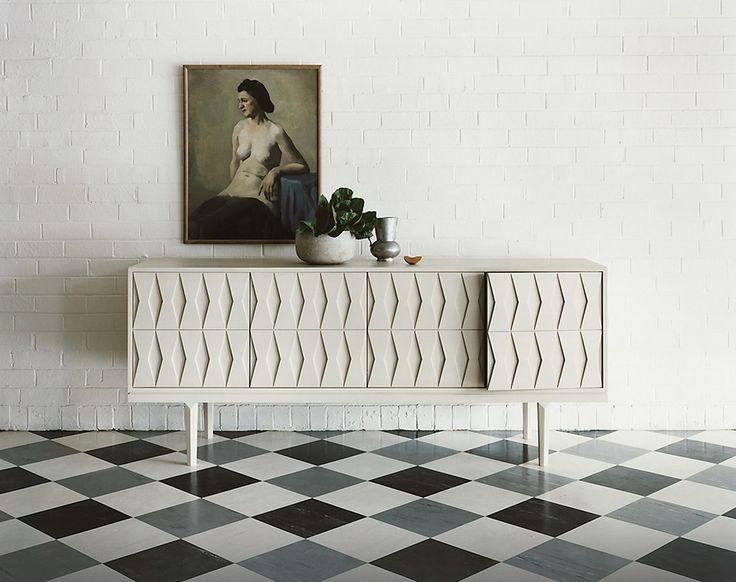 white credenza, by Khai Liew, checkerboard floor