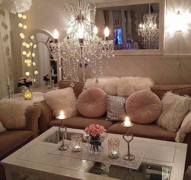 A Low Chandelier And Candlelight Create The Perfect Ambiance For This Living Room Setting
