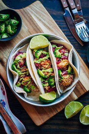 Delicious, plant-based Cauliflower Tacos from The Blissful Basil Cookbook by Ashley Melillo. Made with avocado crema and best served with lime!