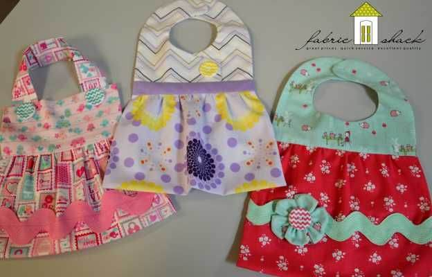 Pretty in Bibs pattern by Vanilla House Designs ~ Dressy bibs for baby girls in three very cute versions! Each version comes in a smaller size (3-12 months) and a larger size (12-30 months)! This pattern also has online video help available! Each bib can be made with just two fat quarters! These darling samples were made with Lovey Dovey, Ashbury Heights and Enchant by Riley Blake! Follow this pin to the Fabric Shack, and while you are there browse our selection of over 20,000 fabrics!