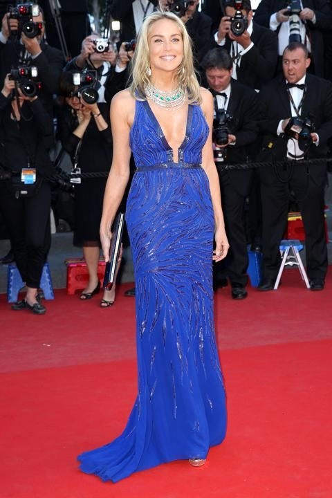 """Sharon Stone: Wearing a plunging, electric blue Roberto Cavalli gown and over-the-top, diamond-and-emerald necklace to the """"Behind the Candelabra"""" premiere during the 66th Cannes Film Festival. (5/21/13)"""