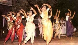 "Dekhni dance, folk dance from Goa, India. The dekhni represents an attractive mixture of folk culture and Western music, danced mostly by Christian girls in fully Indian dress. Dekhni in Konkani language means ""bewitching beauty"". This song-cum-dance performed only by women to the accompaniment of folk drum ""Ghumat"", displays a rare blend of Indian and Western cultures. The dance enacts the life of a ""Devdasi"" (literally meaning servant of God) girl whose job is to perform dance in temples…"
