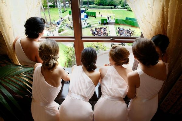 Bridesmaids in Bridal Suite looking down on ceremony site  Photography: Bob %26 Dawn Davis Photography   Read More:  http://www.insideweddings.com/weddings/ashley-hebert-and-jp-rosenbaum/438/