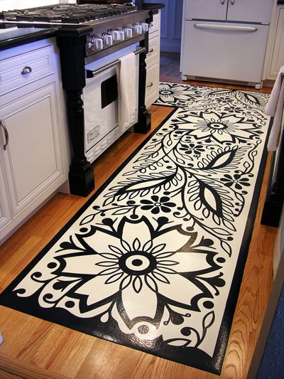 A painted rug on the back of vinyl flooring.  This is GORG