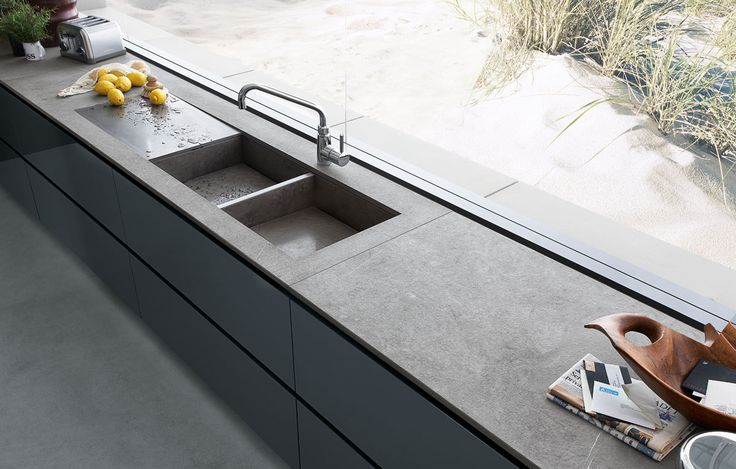 Sink with basins in stone and stainless steel drain.