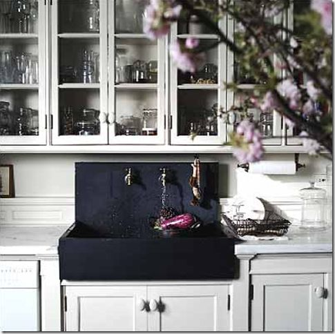black farmhouse #sink in classic white #kitchen. Roman and Williams ...