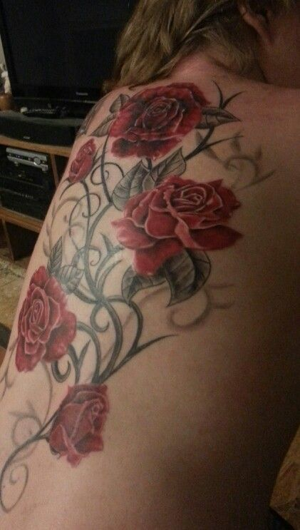 Rose vine tattoo (pink instead of red; side of thigh)