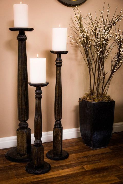 Table Legs Into Candle Pedestals  - Table legs at different heights, screwed into wooden bases for support, smaller wooden bases secured to the tops upside down to create a shelf for the candles, fresh coat of stain or paint and BAM there you go!