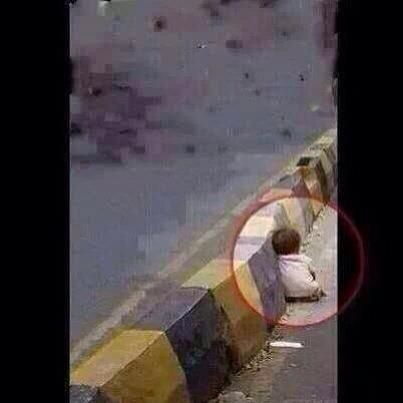 """OMG this picture killed me, a little baby girl hiding from Israeli bombing is she a terrorist? "" #GazaUnderAttack @Saif14Rahman"