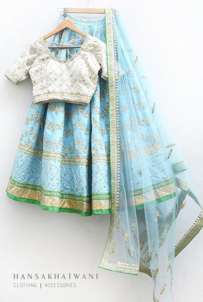 white blouse, pastel blue lehenga, fuchsia green and gold border, gold gota patti work, pastel blue net dupatta