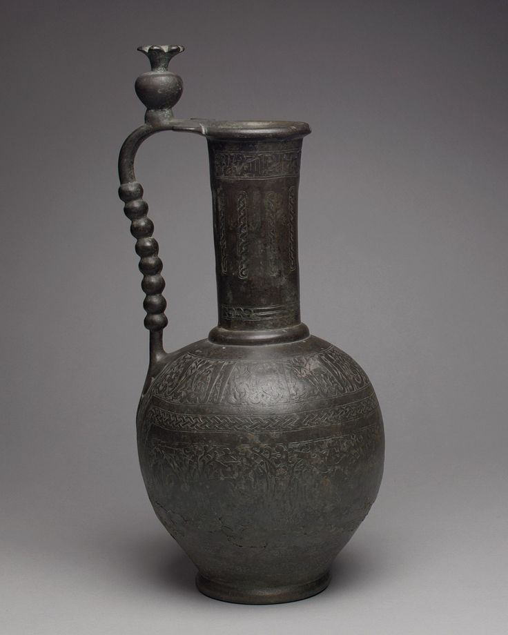 Ewer with Inscriptions and Hunting Scenes Object Name: Ewer Date: 11th century Geography: Iran, Nishapur; Iran, Nishapur Culture: Islamic Medium: Bronze; cast, engraved