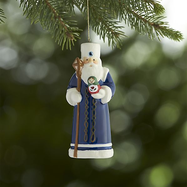 """Our Russian Santa is inspired by the traditional """"Ded Moroz,"""" which translates as """"Old Man Frost"""" or """"Father Frost."""" Ded Moroz brings presents to children; however, unlike the traditional Santa Claus, his gifts are usually delivered in person at a New Year's Eve celebration. His appearance is similar to that of Santa Claus—a coat, boots and long white beard—with the addition of a long, magical staff."""