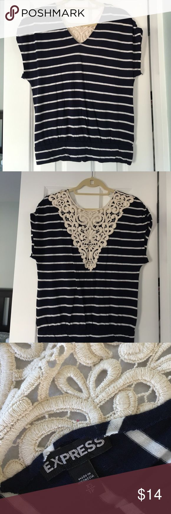 "Express navy blue and white tee. Express Navy blue and white tee with cream colored lace embellishment in the back of the tee. 60% cotton 40% modal. Worn once. Length 14"" from armpit to bottom of shirt. Express Tops Tees - Short Sleeve"
