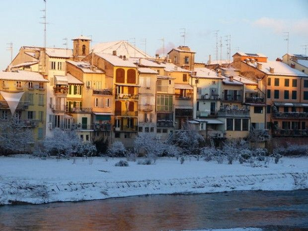 snow-covered houses along the creek