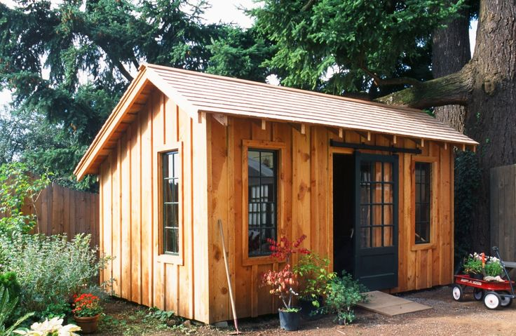tool shed with rough sawn siding and trim  hand