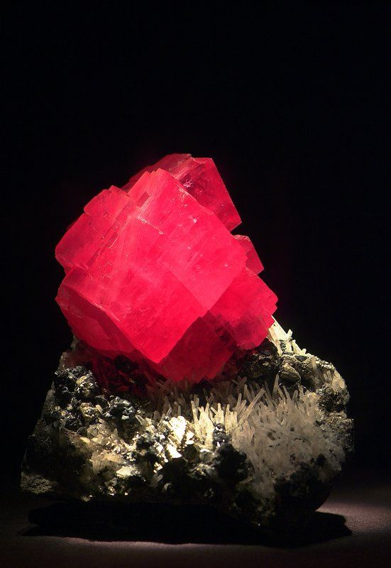 Rhodochrosite. The beautiful pink color of this stone is caused by the element manganese dissolved in ground water and combined with carbon. Found mostly in stalagmite and stalactite form in the caves of Argentina. The Incas believed it to be the blood of former kings and queens turned to stone.